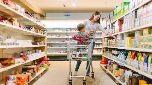 Woman in shop with child in the trolly